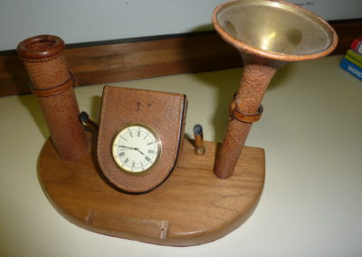 Desk top clock and pen holder